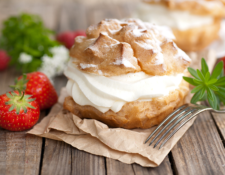 Cream filled pastry with strawberries and fork