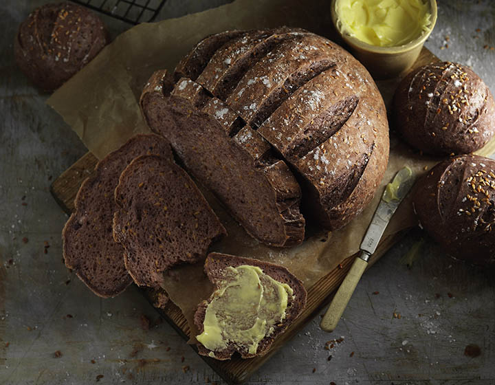 Gluten free brown bread with buttered slice