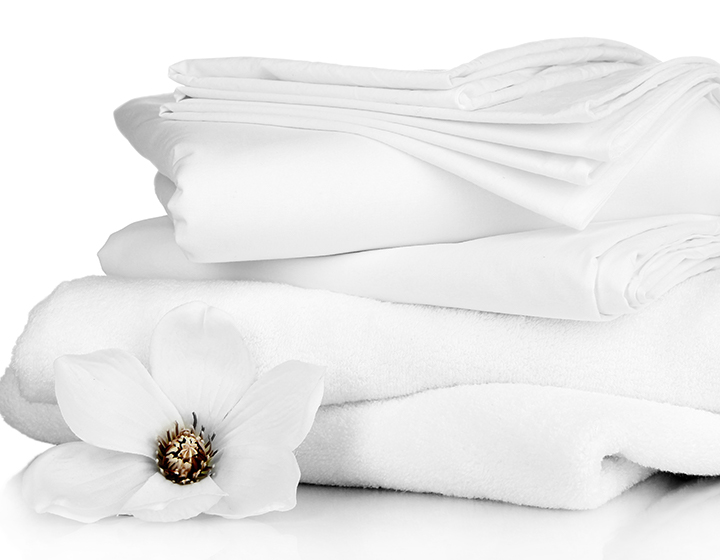 Multiple white sheets stacked, with a white flower