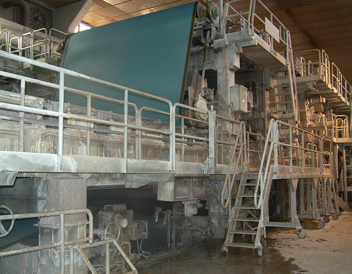 A grey concrete factory on multiple levels